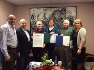 OWBA Creation Team displays plaques received by City Officials at the Inaugural Meeting